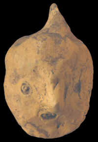 Clay human head figure, Mississippian culture.