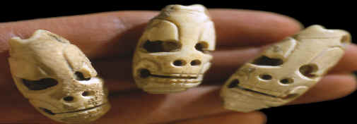 "Mayan ""death head"" marine shell tinklers or beads."