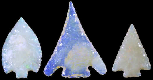 Three Australian opal arrowheads.
